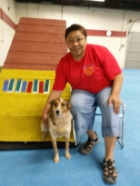 Lorinda McKisson and Keanu show off their ribbons from their debut in CPE agility