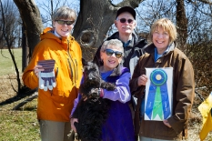 Mary Rice and her Scottish Terrier Einstein receiving her TD award from judge Gretchen Stephenson, tracklayer Joseph Moran, and judge Sue Ammerman at the 2014 Oriole Tracking Test at Fair Hill, MD