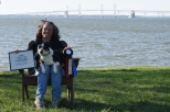 "Raimi Quiton and Renly at the April ODTC Nosework Trial in Stevensville, MD. Renly earned his NW1 title with a ""Pronounced"" designation, which is given to denote excellent teamwork, and placed 3rd overall. Renly also earned a very special honor, the ""Harry award"", which is given to ""the most outstanding rescue dog that demonstrates extraordinary ability and spirit in nose work at the NW1 level,"" according to the National Association for Canine Scent Work. They also took 2nd place in Container Searches."
